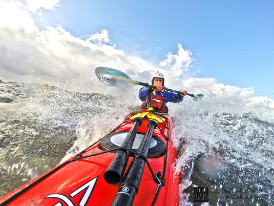David Horkan kayaking with Werner Shuna paddles